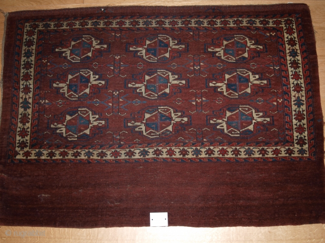 Early Yomut 9 gul chuval, size: 112 x 77cm. Complete with plain weave back.