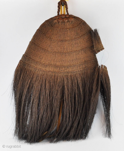 A large Japanese straw hat used by hunters and farmers. Plaited with smoked straw fibers, with a fabric chin-strap. A rare Mingei piece in fine conditions.