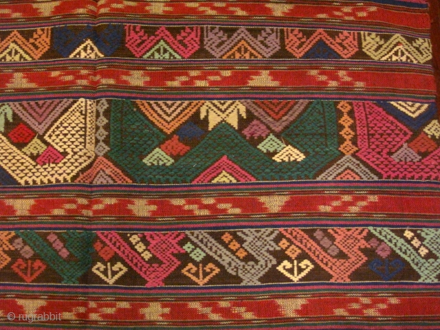 A lovely 'Tai Lue' tube skirt from Laos, possibly from Bo Keaw or Udomxay. All hand spun cotton. A two seams skirt with center banners of discontinuous supplementary weft work in animal  ...