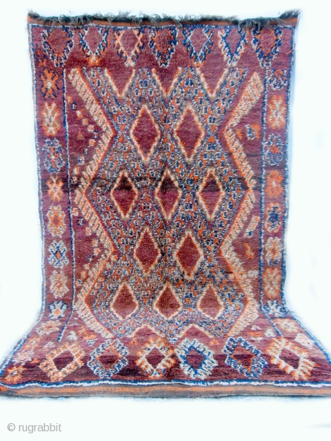 MOROCCAN BERBER MIDDLE ATLAS CARPET although the diamond lattice design is often used in rugs from the Beni Mguild Berbers in the southern Middle Atlas mountains, it is unusual to find the  ...