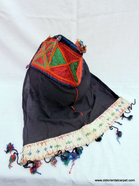 """BERBER CHILD'S BONNET In southern Morocco the French term """"bonnet d'enfant"""" is still used to describe these hats which are worn by very young children in the cold weather. They are handed  ..."""