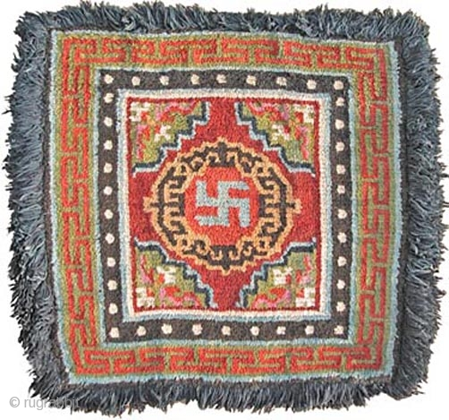 SRW15 Sitting Rug, Tibet, Late 19th-Early 20th 78x82cm excluding fringe Wool warp and weft. Natural dyes.  This rug would have been used on the seat of an important monk or Lama, such that the hairy fringe would  ...