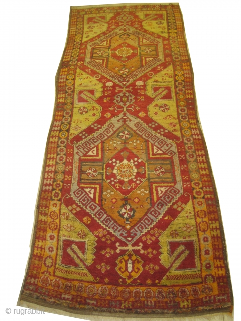 Karapinar Turkish, semi antique, 137 x 360 cm, carpet ID: SRO-11 The background is warm red with two big medallions, thick pile in perfect condition.