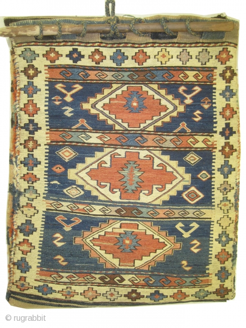 Soumak Caucasian torba 1910  Antique bag, collector's item, vegetable dyes, very fine woven with Soumak technique and hand spun wool, three medallions, indigo background,the back covered kelim is original, perfect condition. Size: 65 x  ...