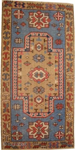 """Fachralo Kazak Caucasian knotted circa in 1915 antique. Collector's item, 92 x 48 (cm) 3'  x 1' 7""""  carpet ID: K-5608 The center medallion and the surrounded large border are soft  ..."""