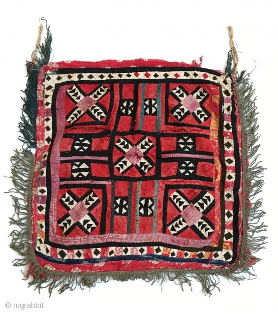 At Torba Ilgich (square ilgich), late 19th / early 20th century, supposed origin: Tajikistan. A complexe patchwork work (imported cloth) with some embroideries (silk thread) and a crochet fringe. Wear consistent with  ...