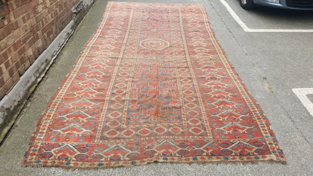 A beautiful Antique Beshir Kelleh mid 19th or earlier. Lovely colours though needs a clean. The piece is solid but has some wear and small areas of damage. Size is 400x 180cm approx price does  ...