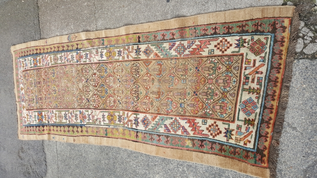 A lovely antique sarab rug with great colours. In used condition and a bit shaped but a beautiful early example,270x100,