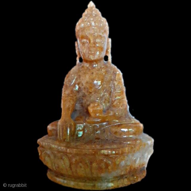 Antique yellow buddha,