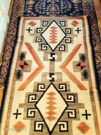"""As found:  An interesting vintage Navajo Crystal rug measuring 3'5""""x 5'4 with bleeding in the reds, a small hole, spots, fabric sewn on both ends, and needs binding reinforcement.  The  ..."""