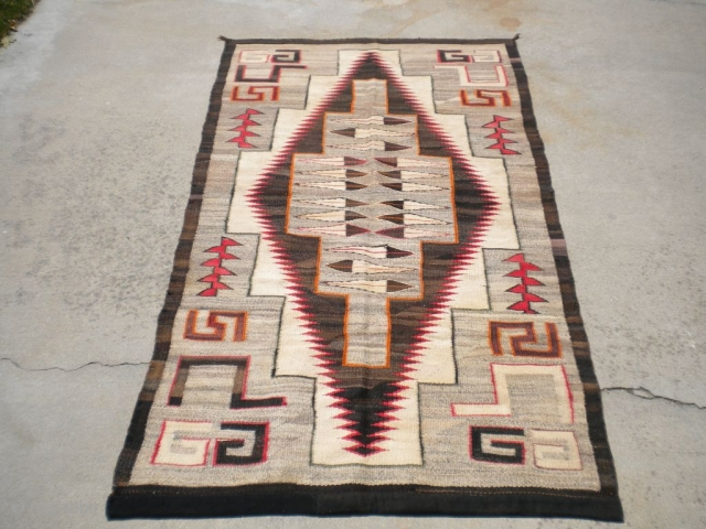 "Rug Curator's find as found: A 1930's to 1940's Navajo measuring 45""x 84"" in very good condition.  Thanks for looking."