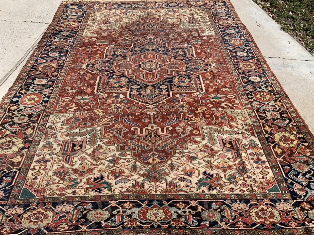 """9'7""""x 12'9"""" Heriz from 1900, dusted and washed, date and signature woven in rug, rug has some exposed foundation in a couple areas, low pile, rug is priced accordingly. No dry rot,  ..."""