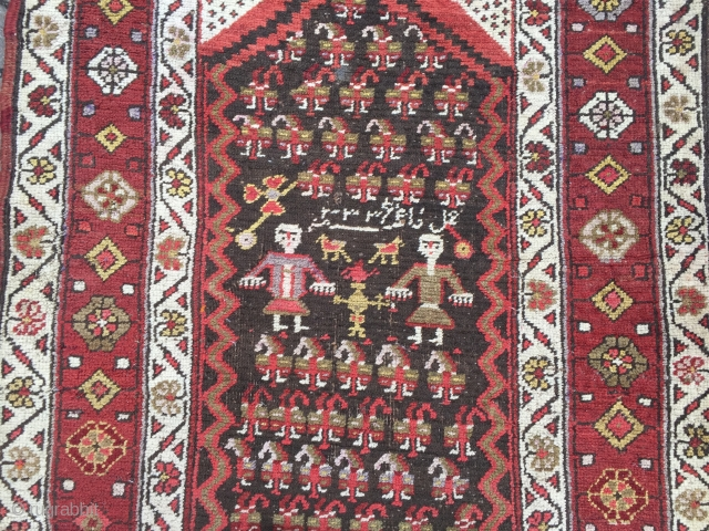 Antique Persian Bidjar runner with a lovelyl couple of Kurdish village people, signed and dated. Wool on wool foundation, size: 365x100cm / 12ft x 3'3''ft , little old moth damage at the  ...