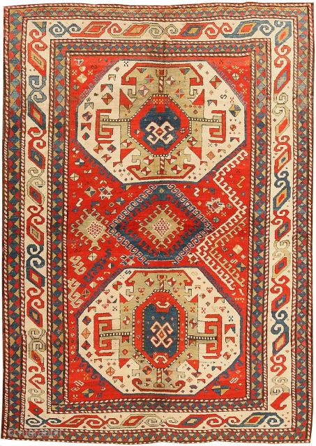 Antique Oriental Rug - Kazak Caucasian Rug, Late 19th Century - Three polygonal medallions in the field adorn this lively antique Kazak Caucasian rug. A red background is adorned by blue, green,  ...