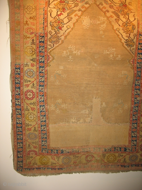 Turkish prayer possibly 18th century. $1100 CHEAP. Large areas of old restoration.From the May estate ( the May Company ). Friends of the Ballards in the 1920's. Has old backing cloth that is  ...