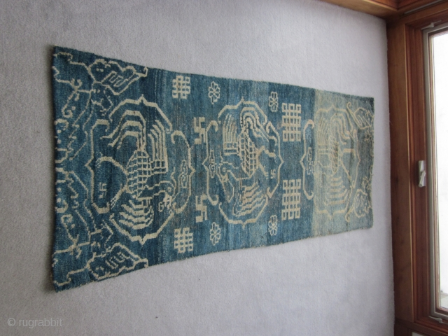 Primitive, village woven Tibetan khaden or runner, 26 by 56 inches. Three large improvised phoenixes in their own cartouches, with other birds at the corners of the piece. Large endless knot motifs  ...
