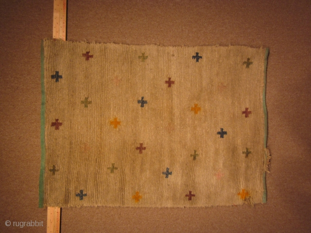 Tibetan: Mat with multicolored woven tigma motifs on natural light brown ground, pre-1900