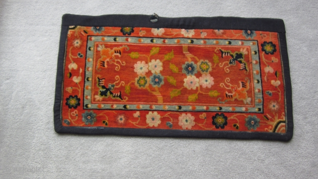Tibetan, small mat, 18 by 35 inches, possibly for table top use.Sewn on border covers about 1 inch of outer edge. After 1900