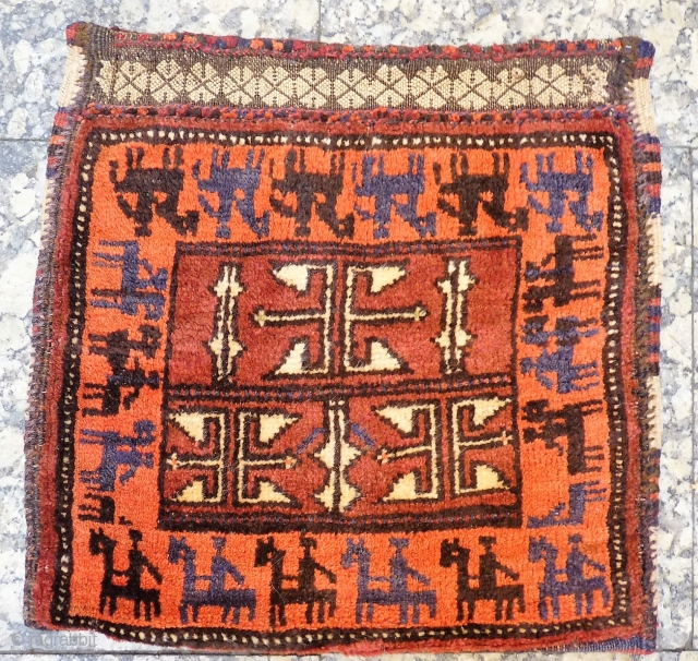 We found the lost cousin of the Pazyryk rug! A remarkable little Belouch bag with soft and shinny wool, framed by a row of horses each with their own horse rider. All  ...