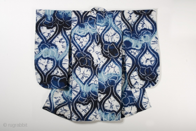 This is a wonderful Japanese children's yukata, or cotton kimono, with a bold shibori dyed pattern of undulating lines and flowers. This dyed pattern was created using multiple techniques, including ori-nui (folded and stitched) and  ...