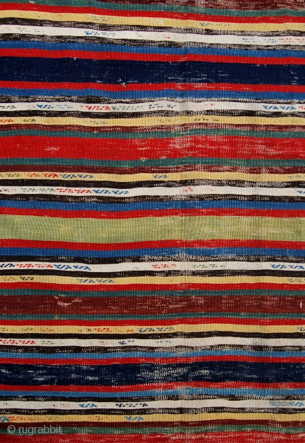 Super and probably quite early banded Qashqai kilim. Rich dyes and a soft handle. Poor condition which is reflected in the price. But still vey charming.