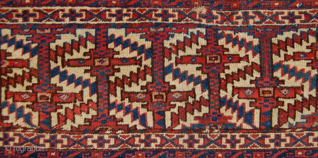 Unusual Yomut group torba fragment. 19th century. 90 x 39cm. Symetrically knotted with all cotton foundation. Needs a clean but a rare thing.