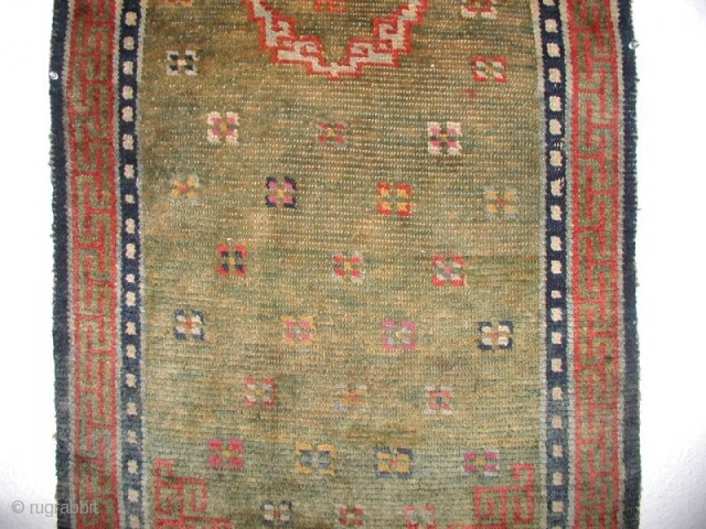 Thick monastic Tibetan khaden on an early green back ground, do not wonder the colors the y are all good bestdyes, please touch it in NY