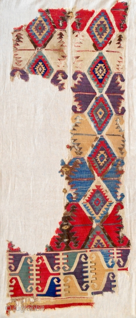 18th c. or earlier Central Anatolian kilim fragment with the best color and classic design. Conserved and mounted on linen. Very fine weave.