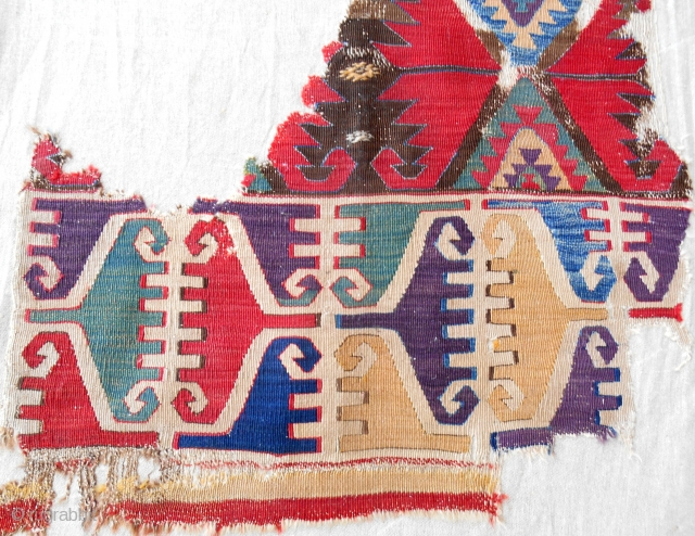 18th C. Central Anatolian kilim fragment with great color and classic design. Conserved and mounted on linen.
