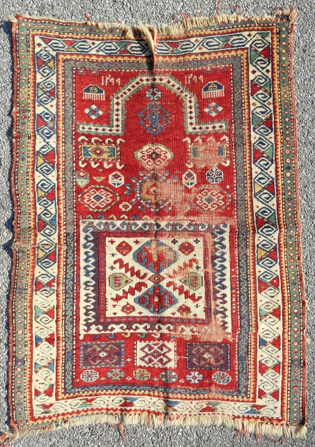 Classic small and very colorful Kazak rug. Dated 1881. Reasonable condition with wear areas. Clean. Restorable.