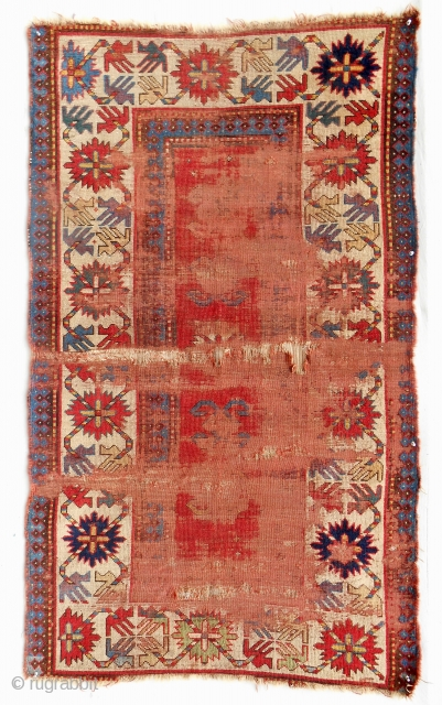 """Distressed but beautiful, early Caucasian Kazak rug with clear, saturated color. Exceptional border design with intriging """"figure/ground"""" geometry."""