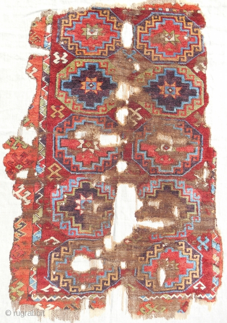 Central Anatolian Memling gul rug fragment. 18th century. The entire field of the rug. Professionally mounted on linen. Good pile & excellent color.