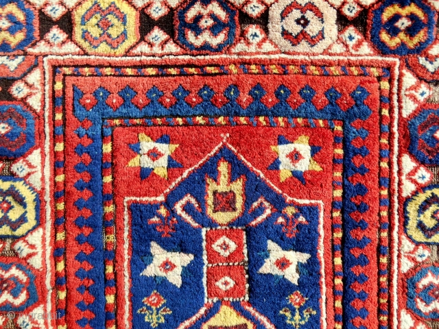 150 year old Kazak or Gendje large rug fragment (detail) with absolute full, original pile. Conserved and professionally mounted on linen.