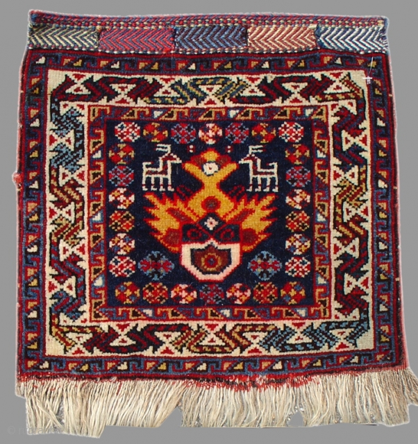 Qashqai Bagface Southwest Persia, c. 1900  This small bagface represents much of what is loved about Qashqai weaving, varied and saturated color, soft wool and a variety of geometric, animal and floral elements throughout.  ...