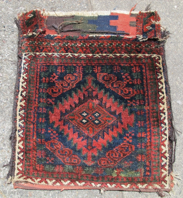 This handsome Baluch bag with a classic 'Mushwani' type diamond and ashik design was woven in southeastern Persia in or near the region of Sistan in the nineteenth century. Both palette and  ...