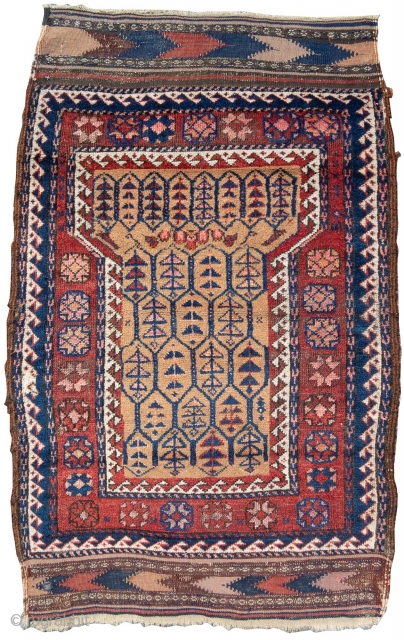 """Baluch rug with an erratic field widening at the top. Camel hair ground color. Some brown wool worked into the original dark goat hair selvedges. Complete kilim ends. 2'6""""x4'0"""""""