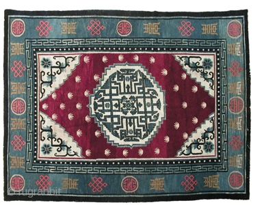 """R-0966 Antique Tibetan large area carpet with a central floral medallion and floral corner cartouche motif in white and shades of indigo against a wine red field with """"frog's feet"""" motifs. The central  ..."""