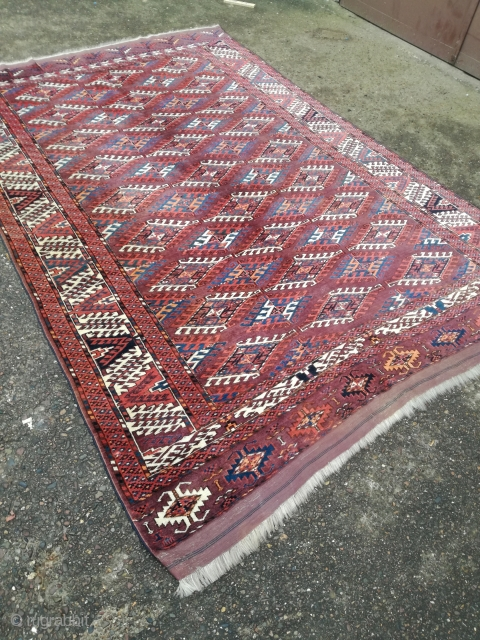 An antique Jomud rug with 290/194 cm. Good shape with even low pile. Original kilim endings both sides.