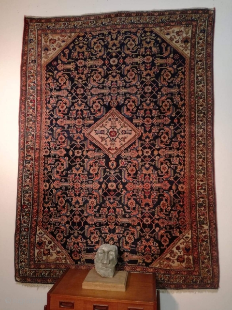 A 100 years old Senneh rug with 200/140 cm. Good condition. One smallest repair one edge. Both side original kilim endings. Very very fine.