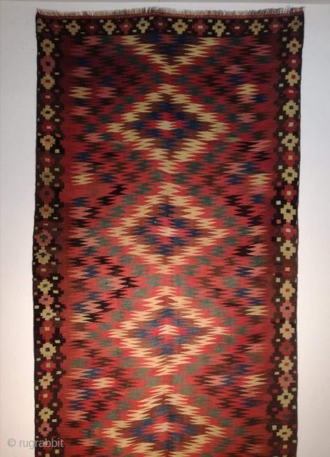 An antique fine Veramin Kilim in very good condition, good colors. 355/135 cm.