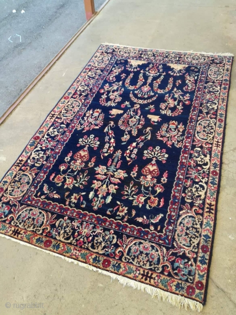 An antique 1900 Kerman rug with rare darblue organic dyes. Parts tinted. Good shape with signs of use. 220/130 cm.