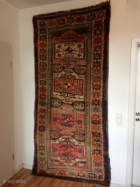An old dated Karabagh with 255/120 cm. Good shape without big restorations. Very thick pile allover.