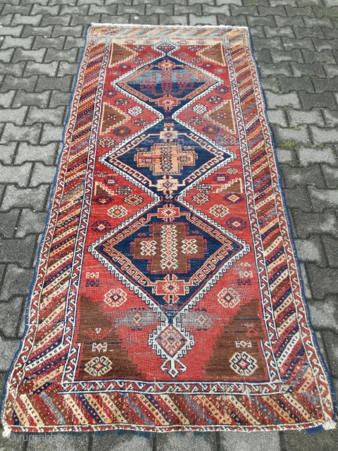 An antique Keladersht with 240/110 cm in used condition. It was a runner, now its cut to a rug.