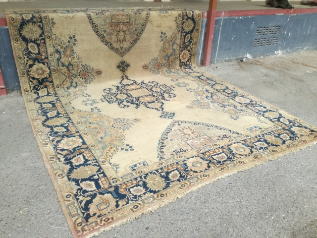 An antique Tabriz or NW Persian carpet with 397/296 cm. As found condition with moth demages and open side.