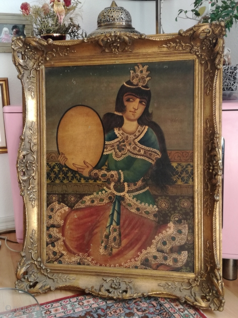An antik 19th century Qajar painting oil on canvas with 80/60 cm plus frame. Signs of use. Fixed on wood carton.
