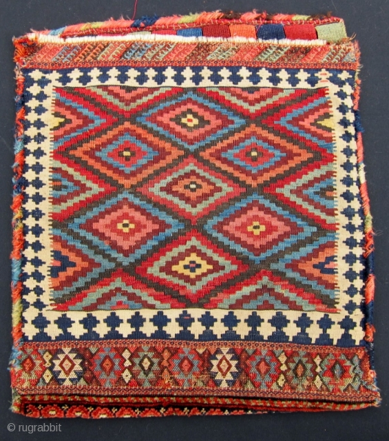 """Beefy antique Kurdish bag, half of a khordjin.  A range of rich saturated colors, full shiny pile, and a remarkably beautiful flatwoven back, 25"""" x 28"""""""