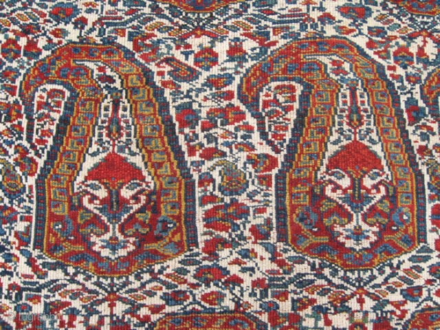 """A beautiful shawl-inspired Khamseh boteh design rug with crisp colors against an ivory ground. Interesting floral filler between the botehs. Bottom 1"""" expertly restored and very small scattered re-knotting in field."""