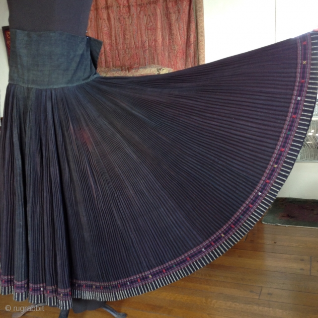 This is a skirt which wraps around the waist like an apron and makes a 360 degree circle when opened up. It was made by one of the minority groups in China  ...