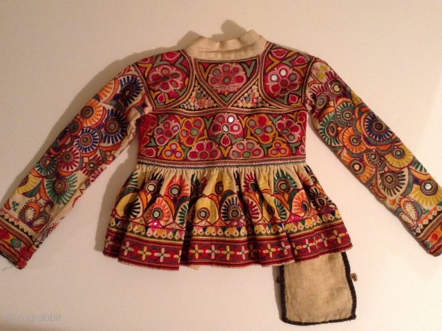This is a child's dress from Gujarat, India.  It is a wrap around dress that looks to be about a size 3 to 5.  It is in very good condition  ...
