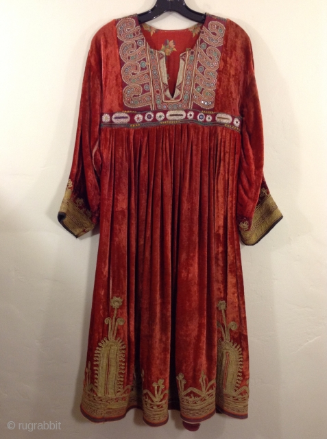 This is a velvet dress from India embroidered with metallic thread.  It is in very fine condition and is wearable. Medium to large size.